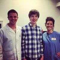 Boy at his final orthodontist visit for braces